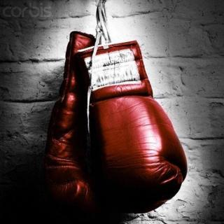 2000 --- Hanging Boxing Gloves --- Image by © image100/Corbis